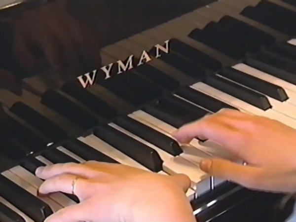In this screenshot one of the Duggar's is playing on their new Wyman ebony grand piano.